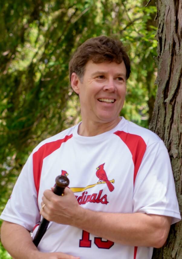 Tim in a baseball uniform