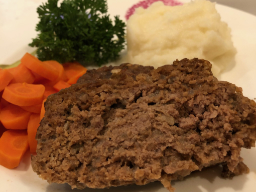 meatloaf, carrots, mashed potatoes on plate