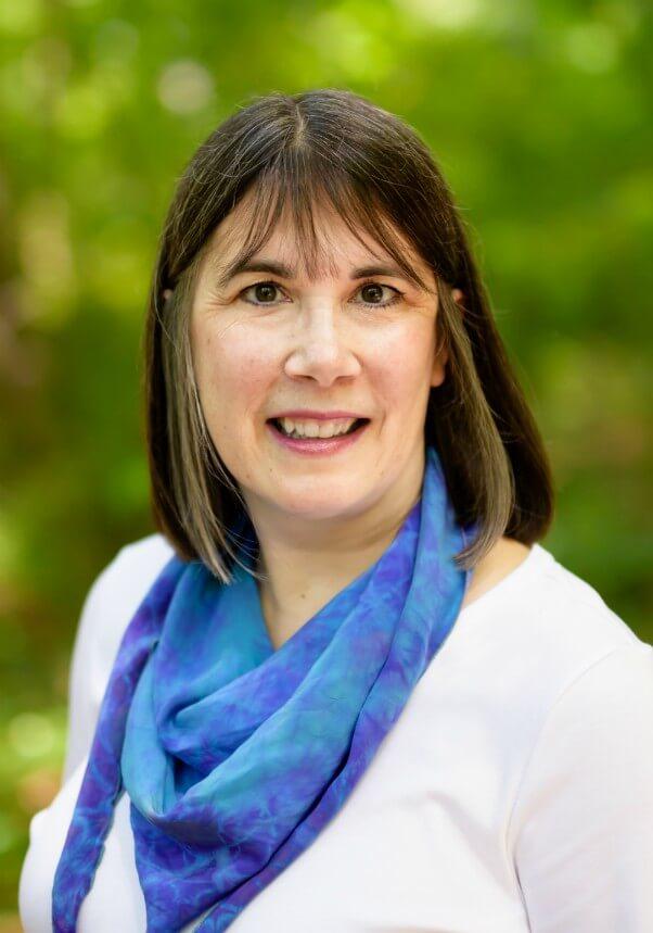 Cindy Sullivan, dietitian, in a white shirt & a blue tie dye silk scarf