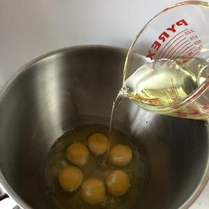 adding oil to eggs
