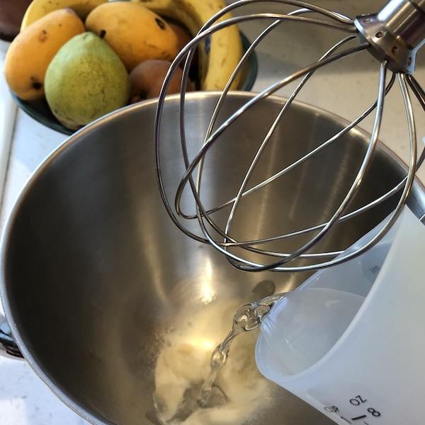 adding water to gelatin in mixer bowl
