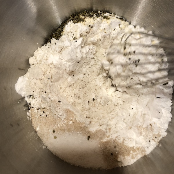 whisking dry ingredients in a stainless steel bowl