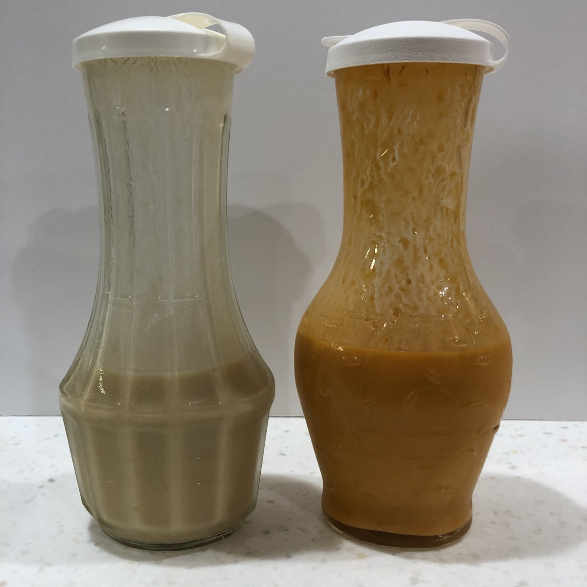 two salad dressings in two containers