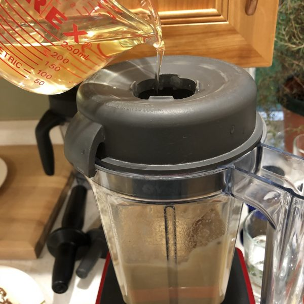 pouring oil in blender container
